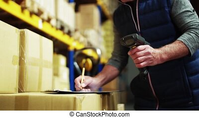 An unrecognizable senior male warehouse worker or a...