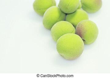 an unripe ume [plum]