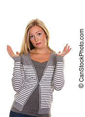an unsuspecting woman shrugs. shrug of helplessness and