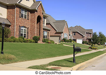 An upscale neighborhood of beautiful brick homes and landscaped yards.