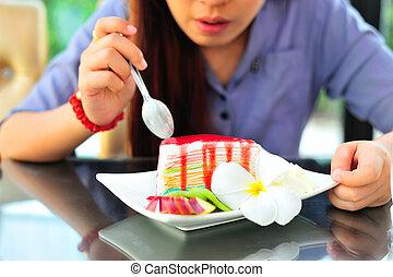 Womenl eating fancy cake in soft light