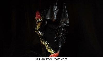 Anaconda and woman in black hood