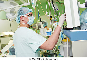 anaesthesiologist doctor at cardiac operation -...