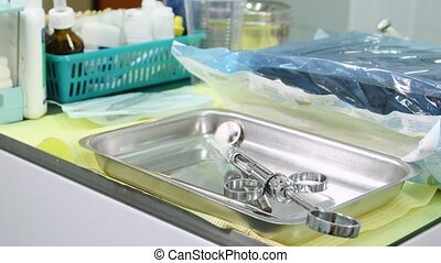 Dental tools on table - Anaesthetic syringe. Dental tools on...