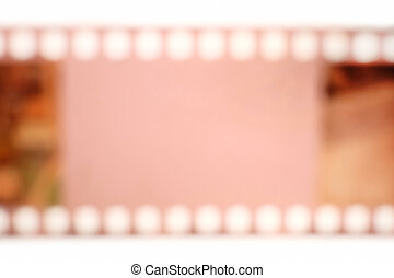 Analog color film in blur with a copy-paste space for text in the centre. Blurry empty 35mm film frame.