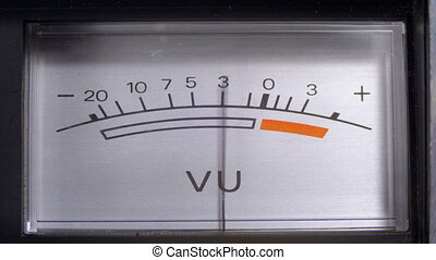 Analog Signal Indicator with Arrow. Meter of the audio signal in decibels. Indicator Gauge Signal, Level Meter. Dial gauge modes Tape Recorder. Close-up. White scale of the device, black numbers.