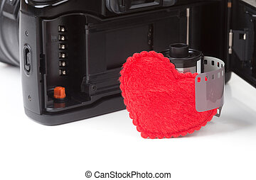 Analog SLR camera with film and heart