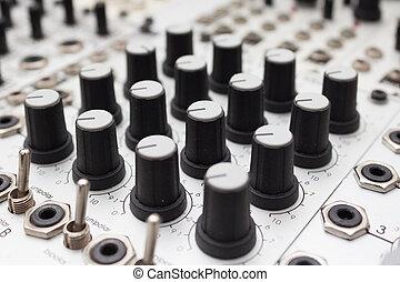 analog synthesizer , knobs macro on music equipment