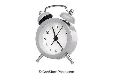 Retro analog table alarm clock isolated on white background