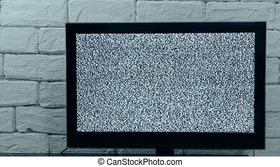 Analog TV signal with glitching effect. Loop video. Indoor...