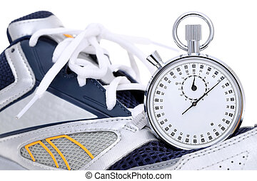analogue stopwatch with sport running shoes on white ...