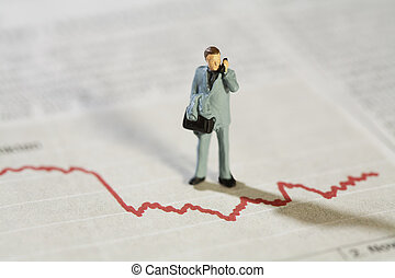 Analysing Business Statistics, a miniature model businessman...