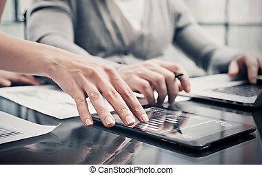 Analytical department working process.Closeup picture woman showing business reports modern tablet screen.Statistics graphics screen.Banker holding pen signs documents,discussion startup.Film effect