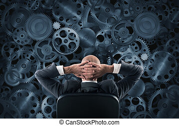 Analyze a system - Businessman sitting in a chair watching ...