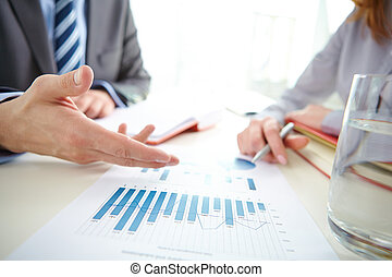 Analyzing chart - Businessman hand pointing at chart and...