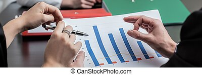 Analyzing company profits - Panoramic view of analyzing...