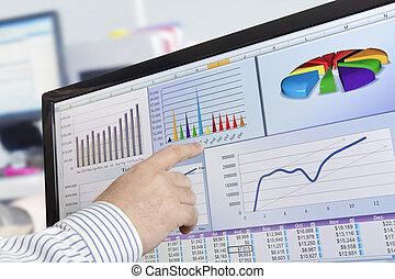 Analyzing data on computer - Man analyzing financial data...