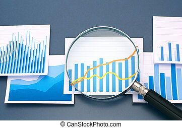 Many graphs and magnifying glass on dark blue background.