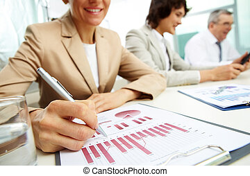 Analyzing progress - Female business lady carrying out the...