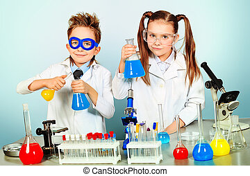 analyzing - Two children making science experiments....