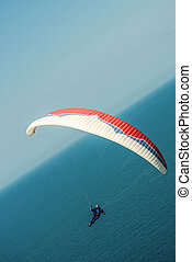 ANAPA, RUSSIA - MAY 1, 2016: man trains with the paraglider over sea