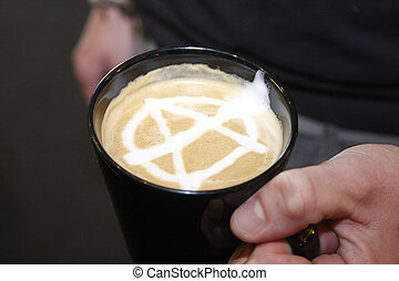 Anarchy Coffee - A cup of coffee with an anarchy sign drawn...