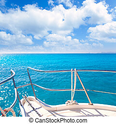 Anchor boat y tropical idyllic tropical turquoise beach under blue sky and clouds