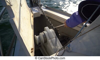 Anchor chain with a winch