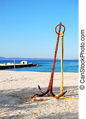 Anchor on the beach and turquoise water at the modern luxury hotel, Halkidiki, Greece