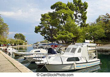 Anchorage ground in Trogir, Boats anchor at the seafront in Trogir - UNESCO town and harbour on the Adriatic coast