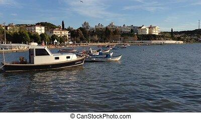 anchored fishing boats during sunset at Aegean sea