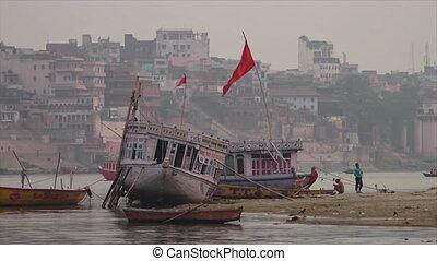 Anchored local boats in Ganga River, India - Medium...