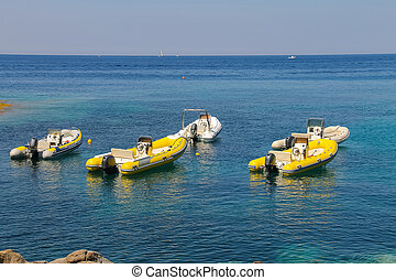 Anchored motorboats in waters of Tyrrhenian Sea, Sant...