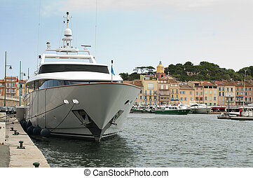 Anchored Yacht in St. Tropez. Ancient buildings on the...