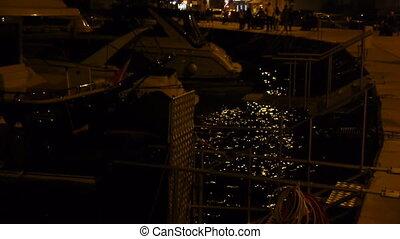 Anchored yacth at night.