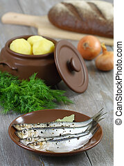 Anchovies and boiled potatoes.