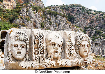 Ancient, abandoned masks and tombs in Myra. Turkey.