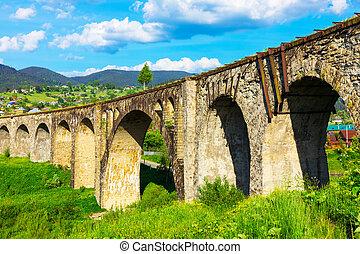 Ancient abandoned railway bridge in Vorokhta, Ukraine