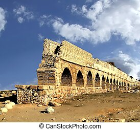 Ancient aqueduct. Israel - Ancient aqueduct at Caesarea. ...