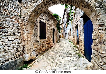 Ancient arched medieval street in an old village in Istria, Croatia