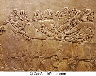 Ancient Assyrian wall carvings of men on a Royal lion hunt
