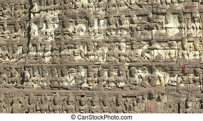 Ancient Bas Relief Carved in Exterior Wall of Temple Ruin