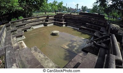 Ancient Bathing Pool in the Ruins of Polonnaruwa, Sri Lanka...
