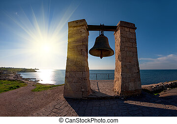 Ancient bell on the coast