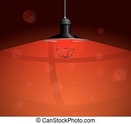 Ancient black lamp hanging with red bulb. Big and empty space illuminated on the dark  wall.