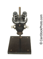 Ancient black microscope for scientific research isolated on white background.