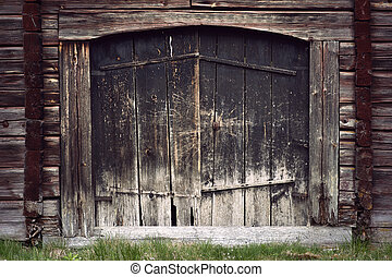 Ancient black wooden door