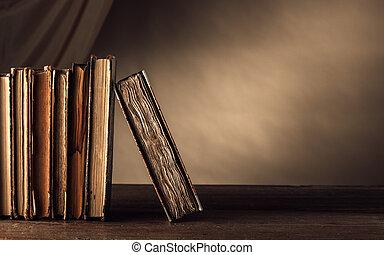Ancient books on a shelf
