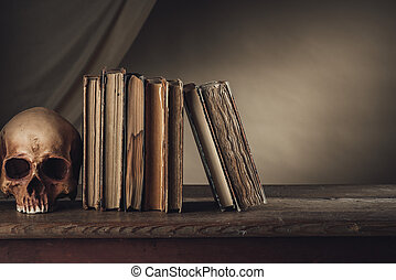 Ancient books with skull