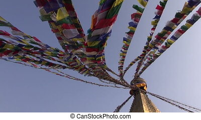 ancient Boudhanath stupa with flags